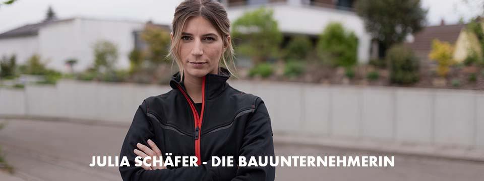 Julia Schäfer trägt die sportliche, moderne und bequeme Arbeitsjacke in Schwarz aus der Performance Kolletion